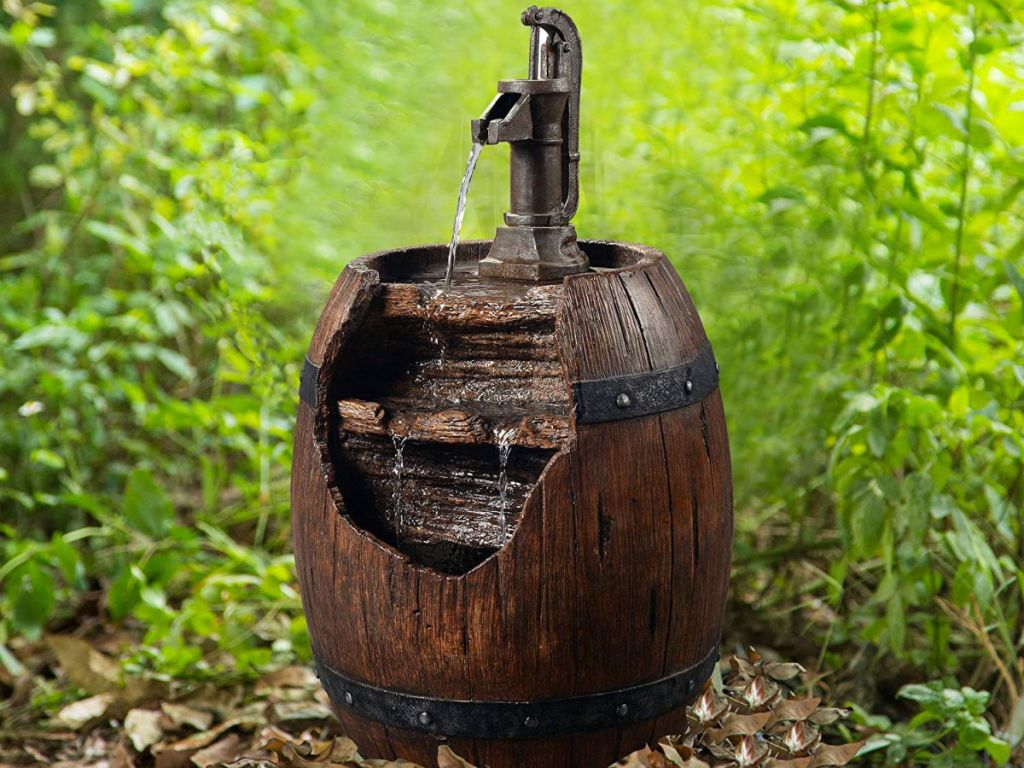 barrel water fountain feature in woods