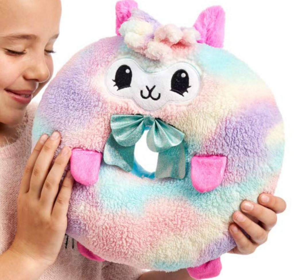 Girl holding llama Pikmi Pops
