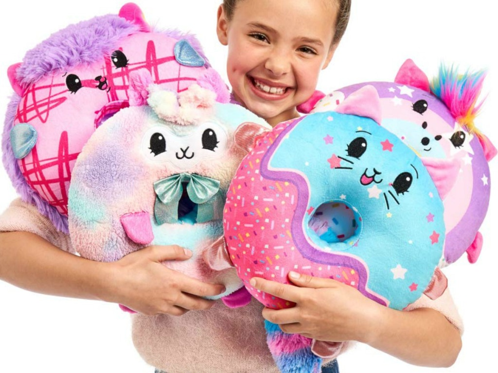 Girl holding Pikmi Pops Doughmi Plush Toy Collection