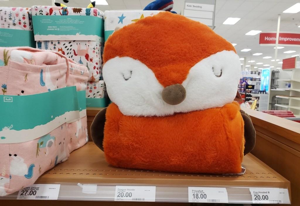 Pillowfort Hooded Blanket on shelf at Target