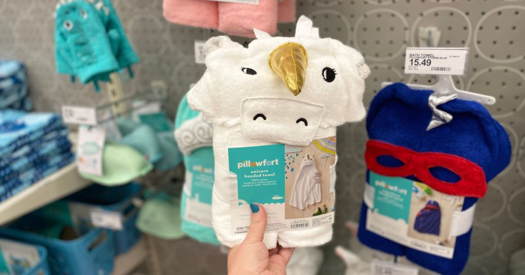 hand holding Pillowfort Unicorn Hooded Bath Towel White in store