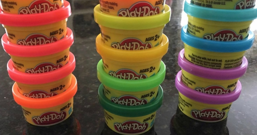 Small containers of Play-Doh on counter