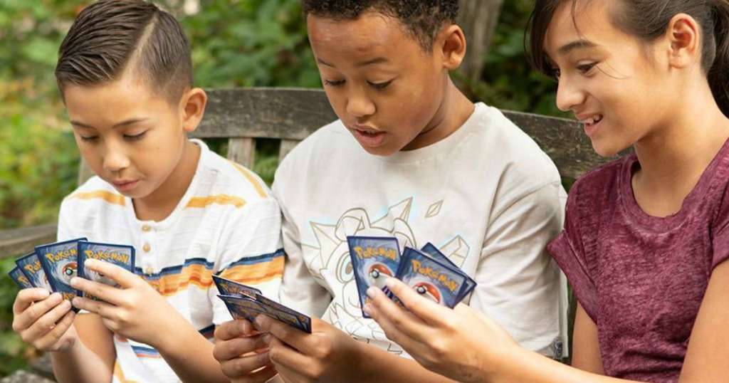 kids playing with Pokemon Cards