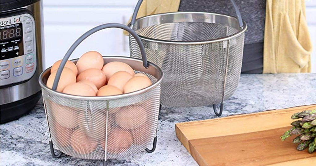 Pressure cooker steamer basket filled with eggs on marble counter top