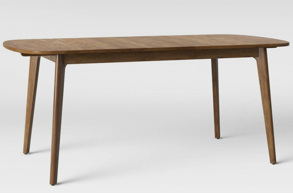 Brown dining room table with middle leaf