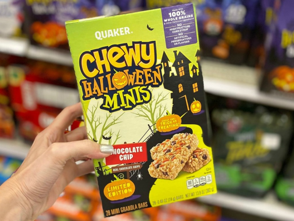 box of Halloween-themed Quaker chewy bars in hand in-store