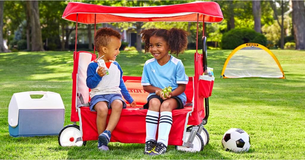 kids playing in radio flyer wagon