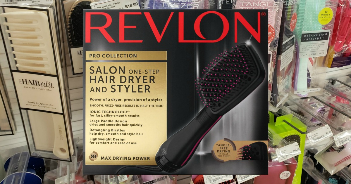 Revlon One-Step Paddle Dryer in box in front of in-store brush display