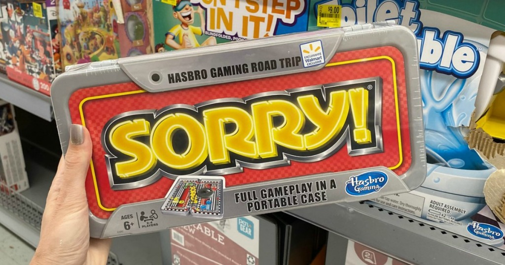 woman holding SORRY! travel game
