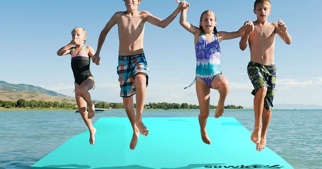 kids jumping off a SOWKT water pad