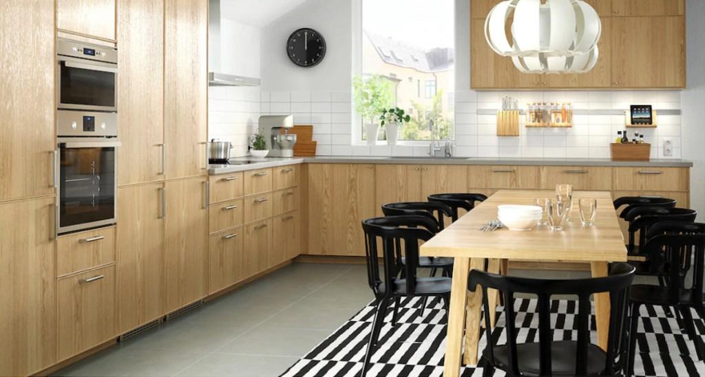 black and white stripe rug sitting in birch colored IKEA kitchen