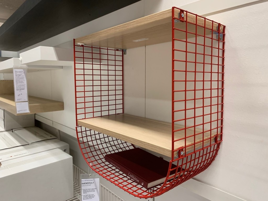 red wire basket shelf on wall