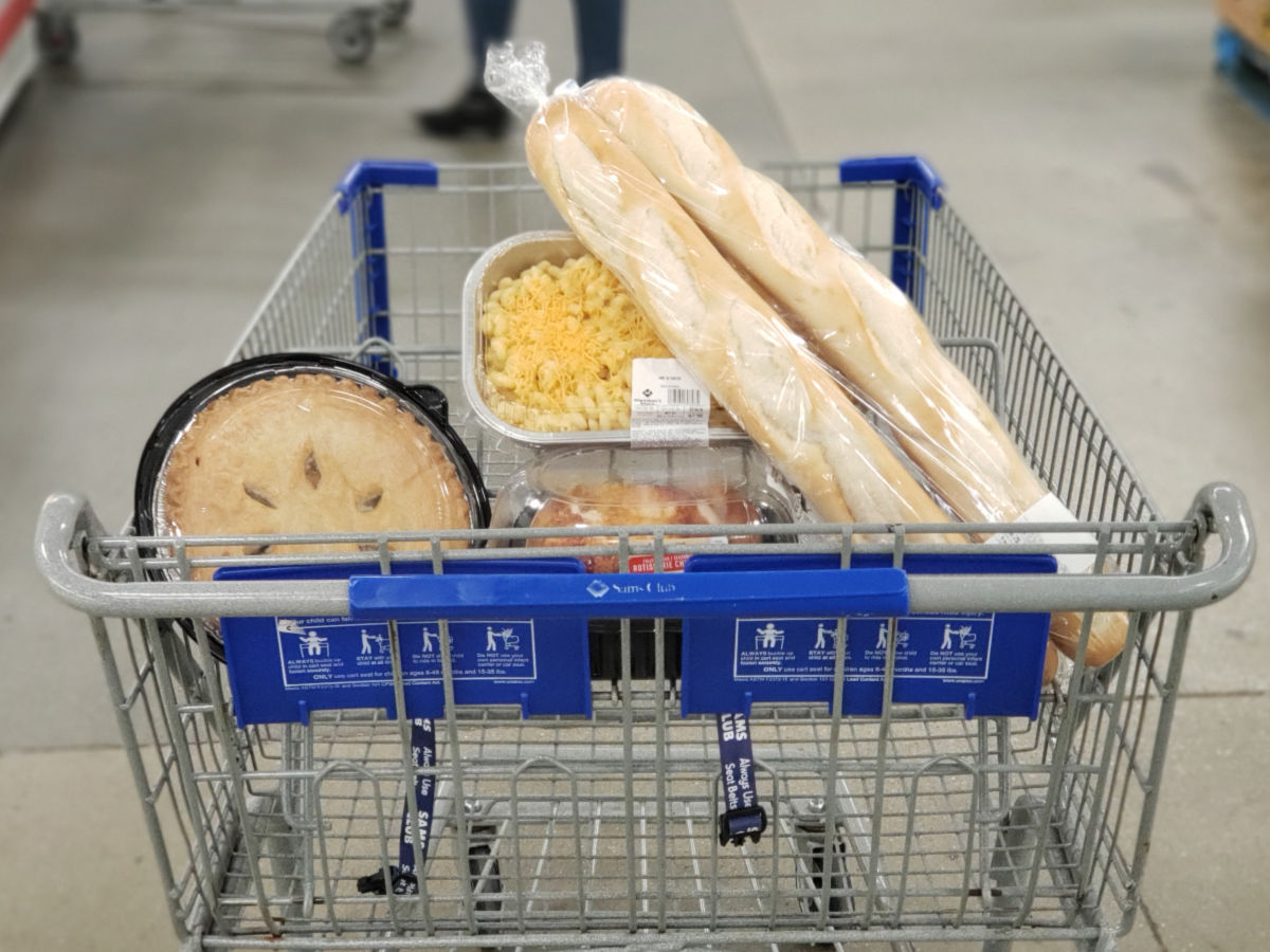 Sam's Club Cart with food with apple pie, macaroni and cheese, and bread
