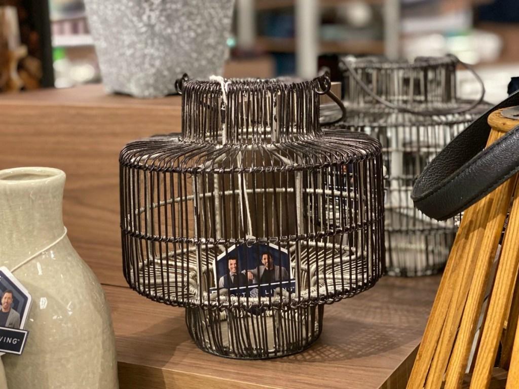Wire pewter metal cage lantern on display at Kohl's