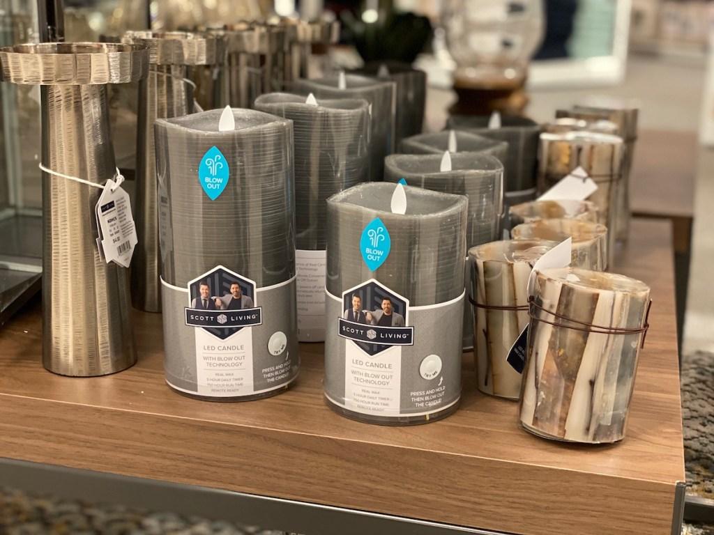 Scott Living Oasis Realistic LED Wax Pillar Candle on shelf