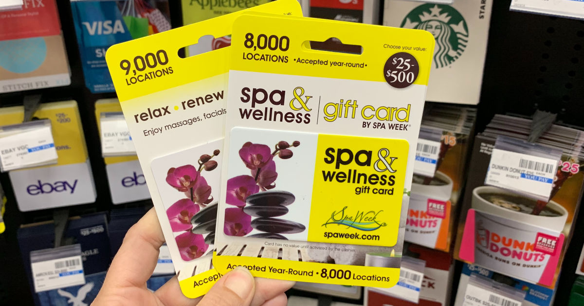 Hand holding Spa & Wellness gift cards