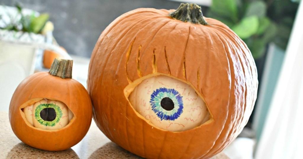 spooky eyeball pumpkins displayed on counter