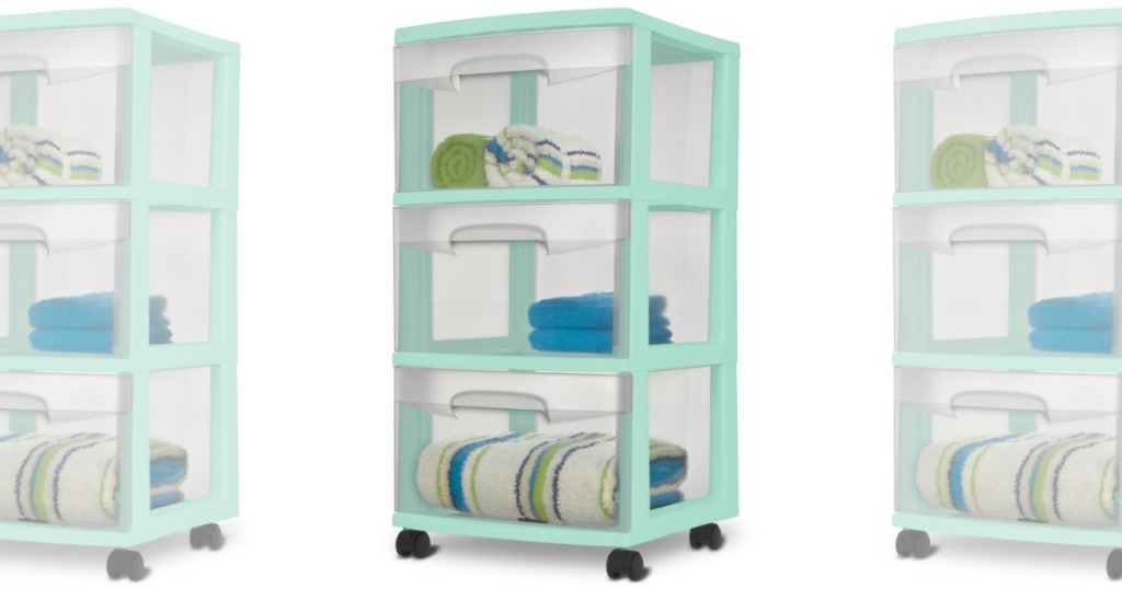 Sterilite storage cart in mint green with towels inside