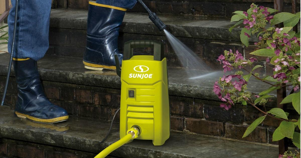 man using Sun Joe Electric Pressure Washer on his steps