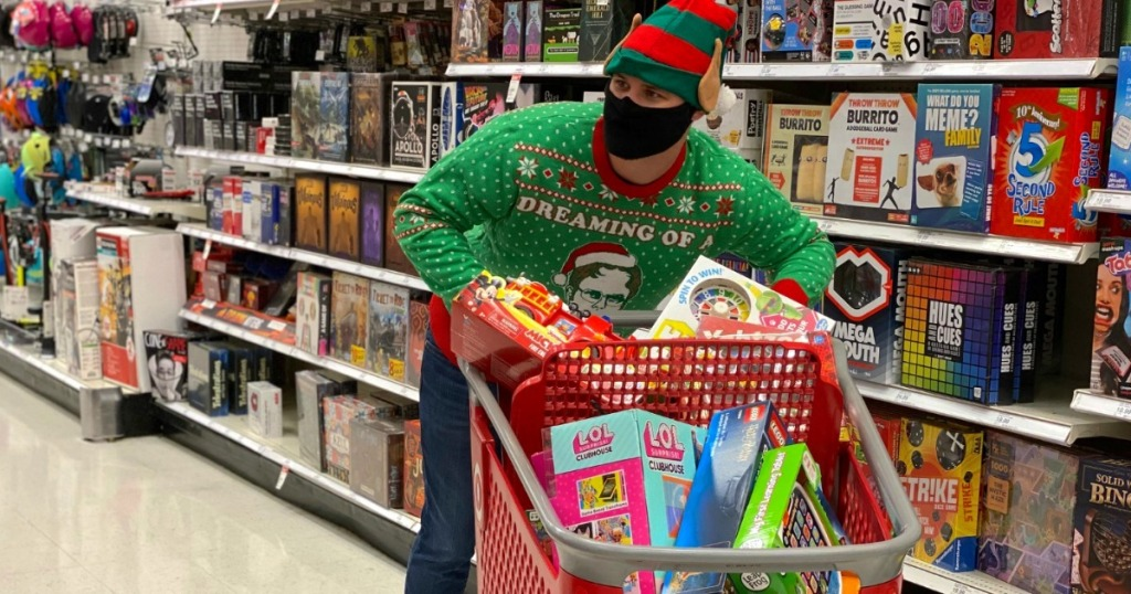 man Black Friday shopping at Target with Christmas sweater