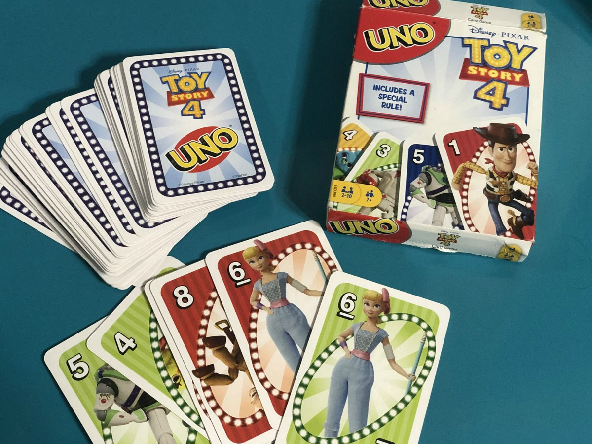 Toy Story 4 Card Game with a teal backround