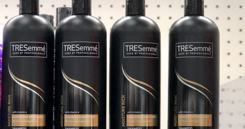bottles of tresemme shampoo on shelf at store