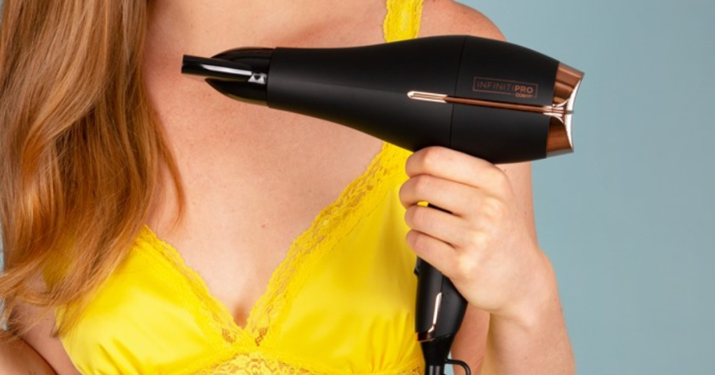woman holding Conair Infiniti pro hair dryer