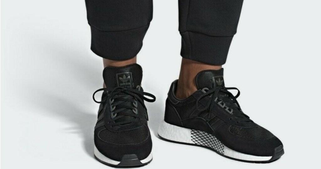 man wearing mens adidas marathonx shoes