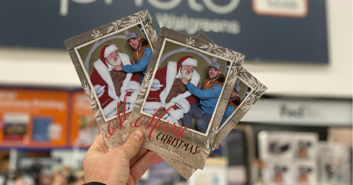 holding Walgreens photo Christmas cards