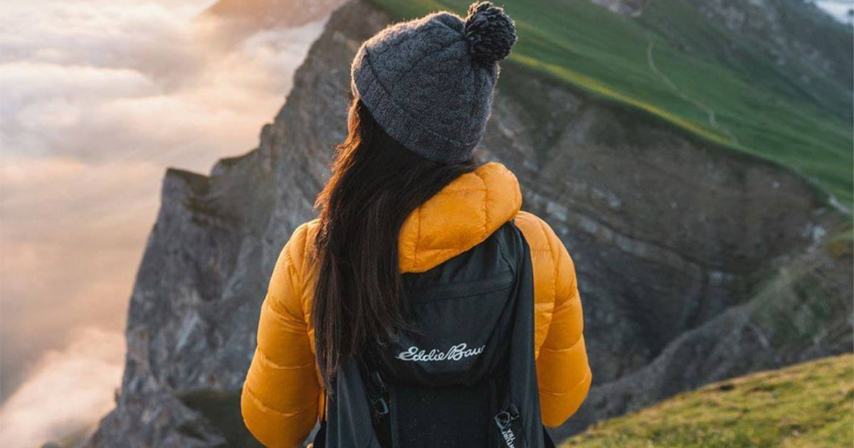 Women with eddie bauer backpack and yellow jacket