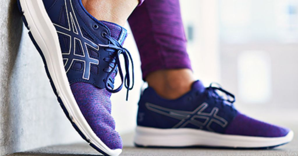 woman wearing pair of asics shoes