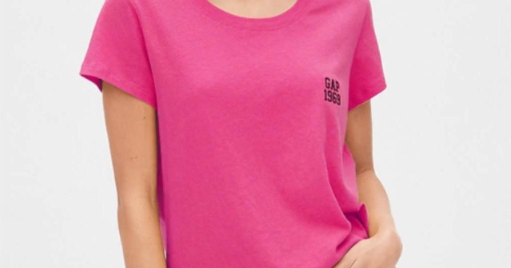 woman wearing pink gap logo crewneck