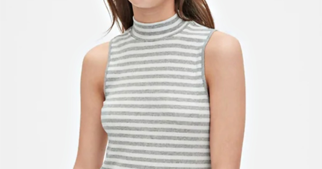 woman wearing white and gray striped tank