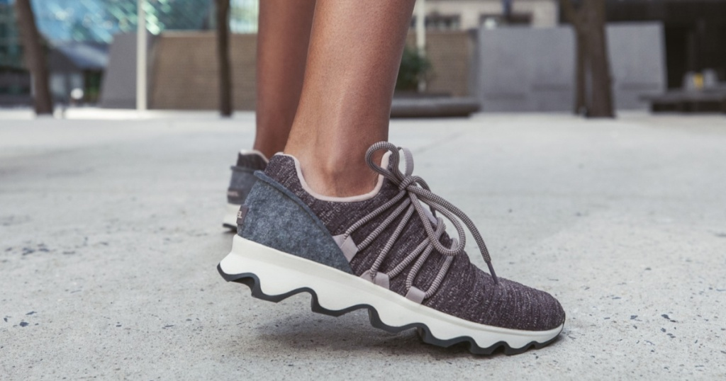 Women's Kinetic Lace Sneakers on woman in street