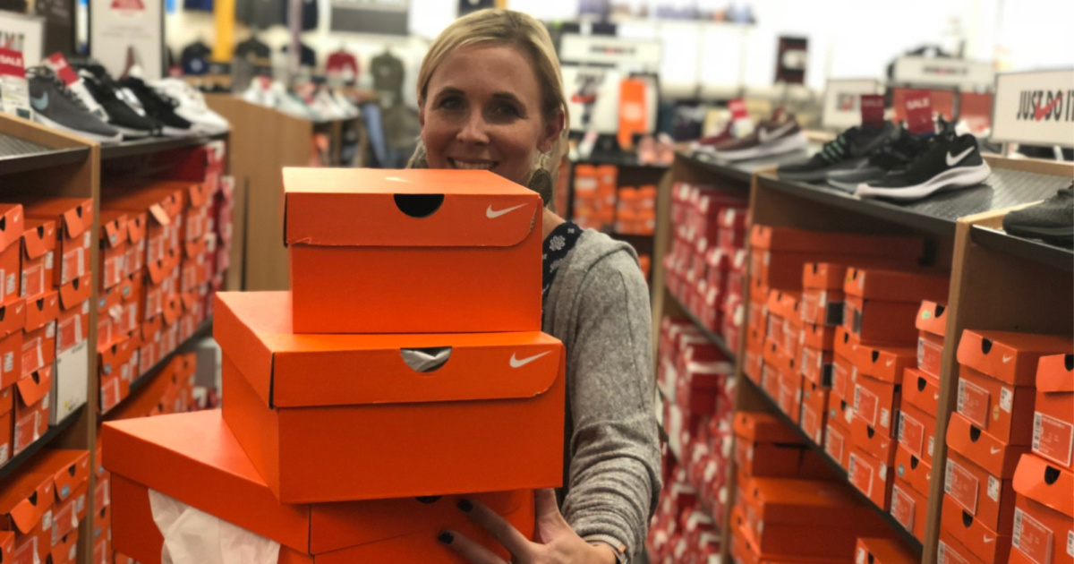 woman holding nike boxes at store