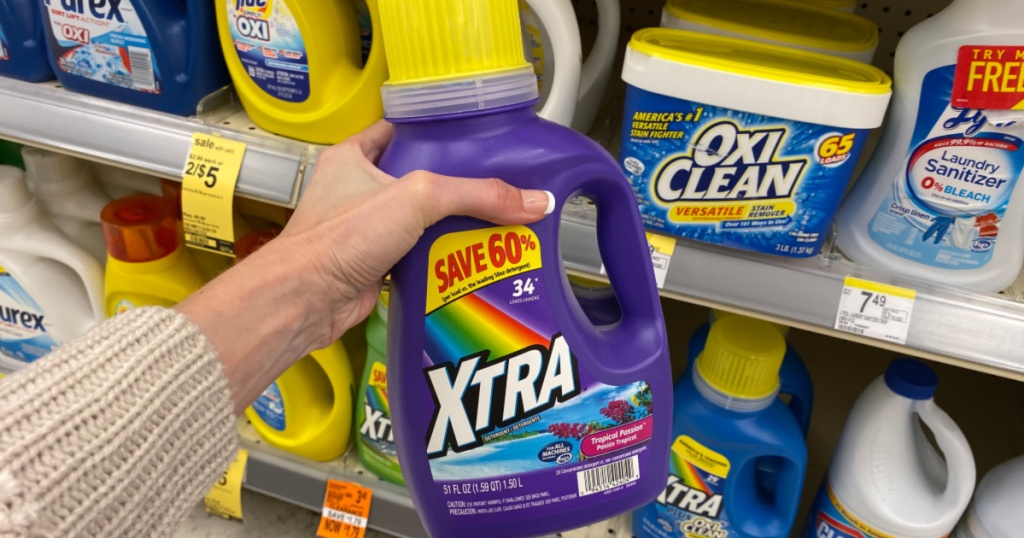 hand holding up bottle of xtra laundry detergent