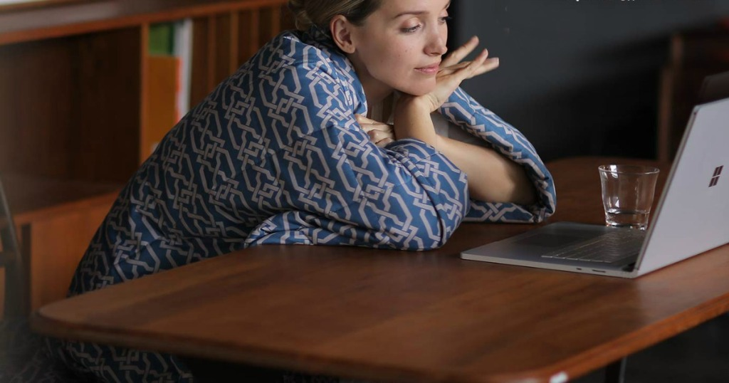 woman wearing a YnM Weighted Blanket
