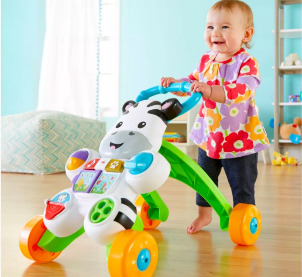 baby pushing a Fisher Price Walker