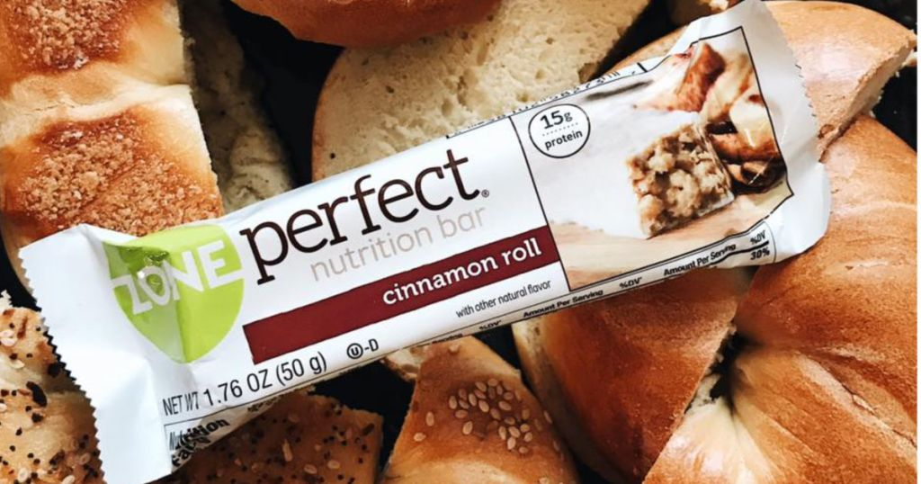 ZonePerfect Cinnamon Roll bar on a bed of bread