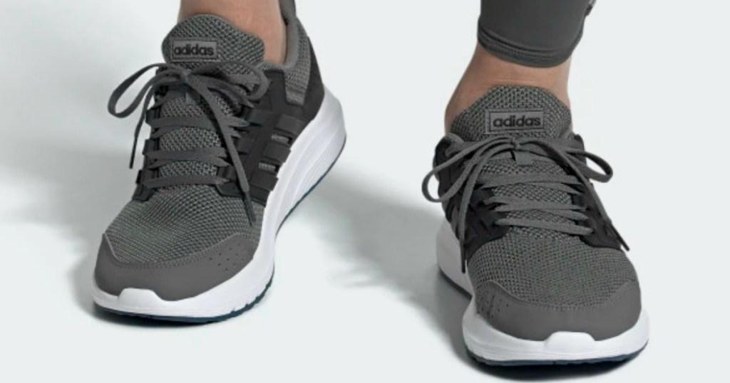 Man wearing adidas Galaxy 4 Shoes Men's in gray