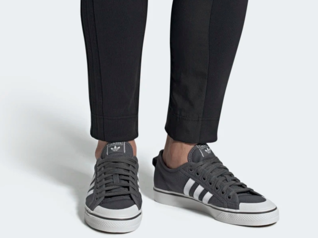 legs modeling gray and white adidas shoes