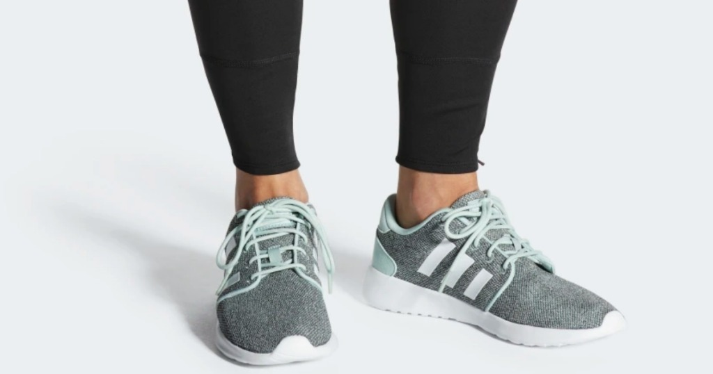 woman wearing adidas racer shoes