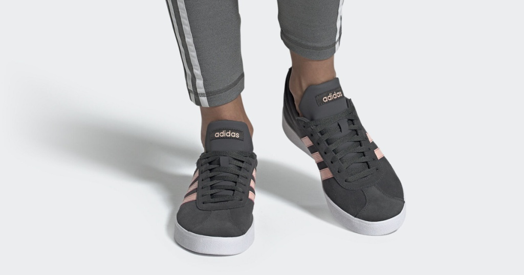 legs modeling gray and pink adidas shoes