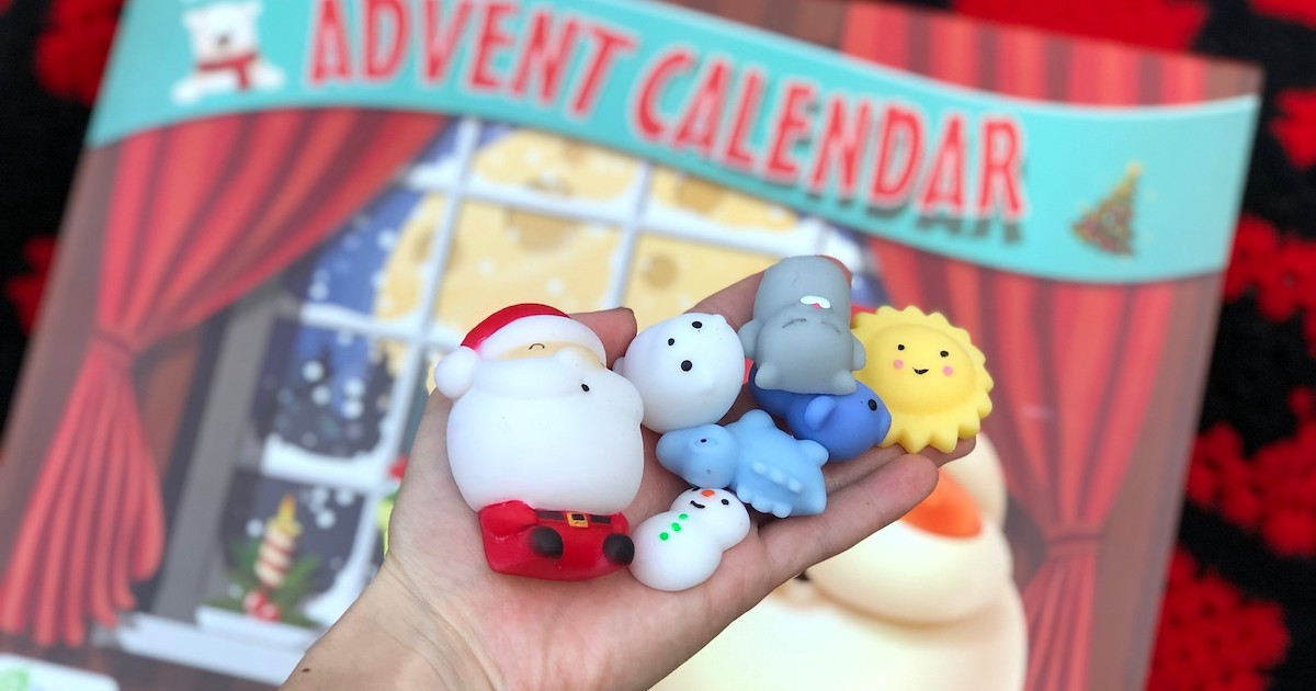 hand holding advent calendar squishes