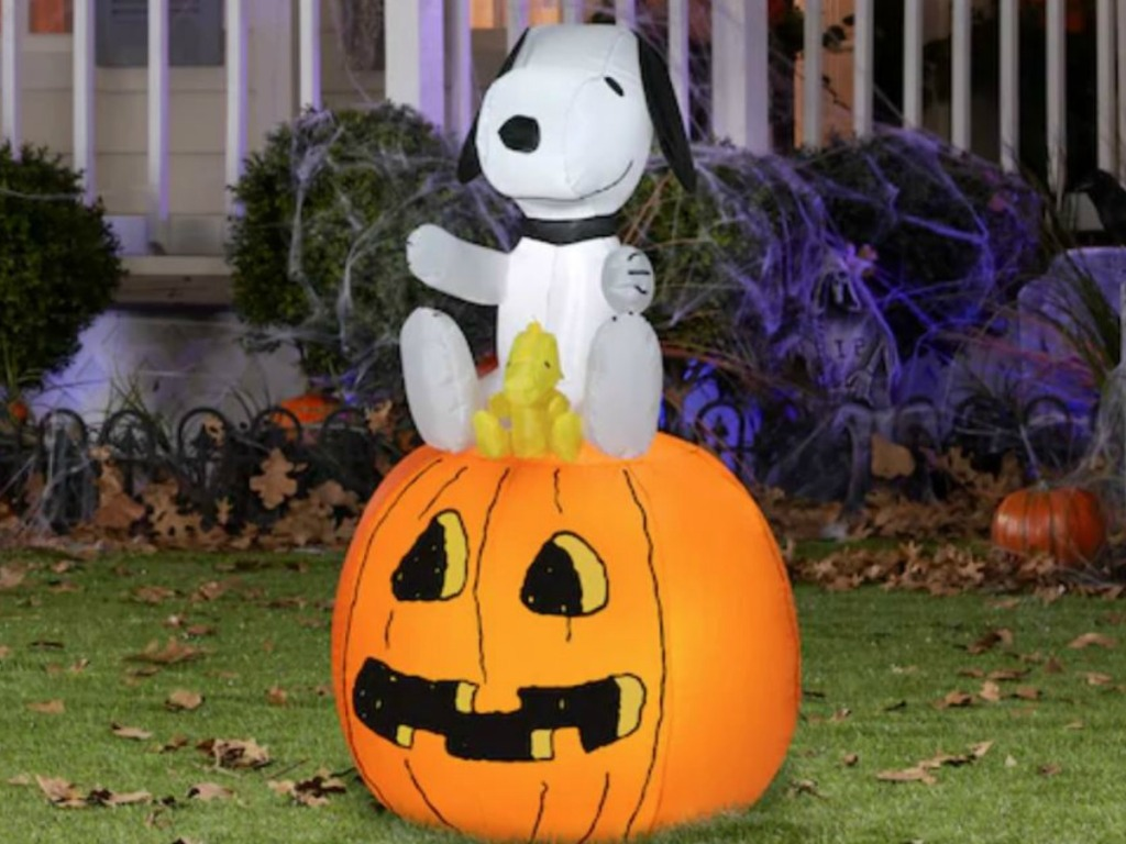 big airblown snoopy and pumpkin on grass