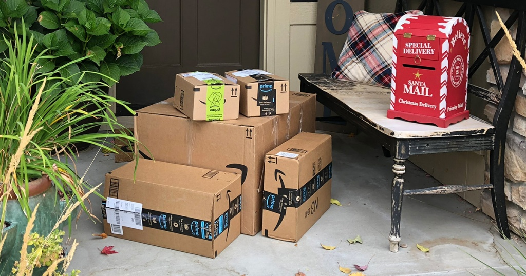 Amazon boxes on front porch with Christmas mail box