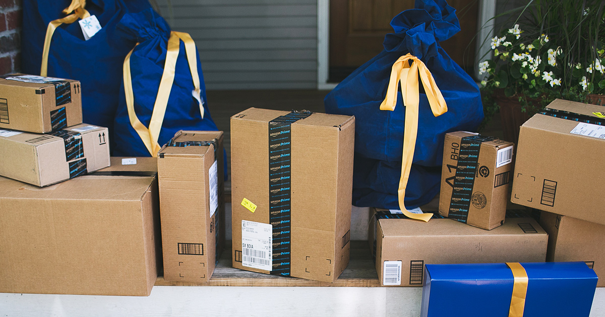 Amazon boxes and gift wrapped packages on front porch