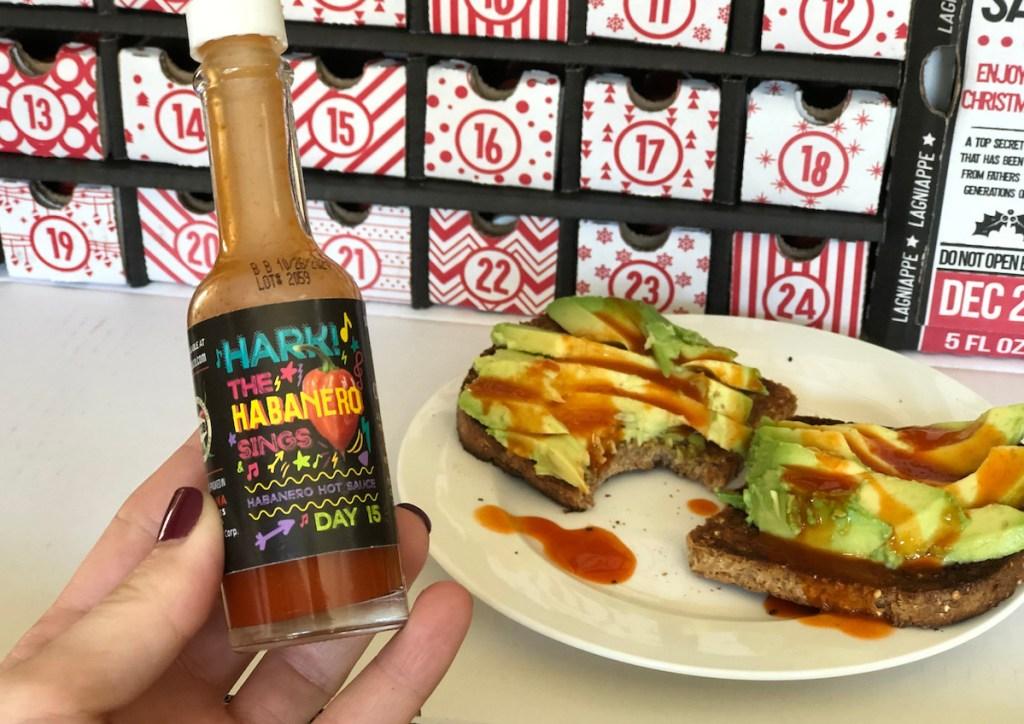 hot sauce on avocado toast with advent calendar