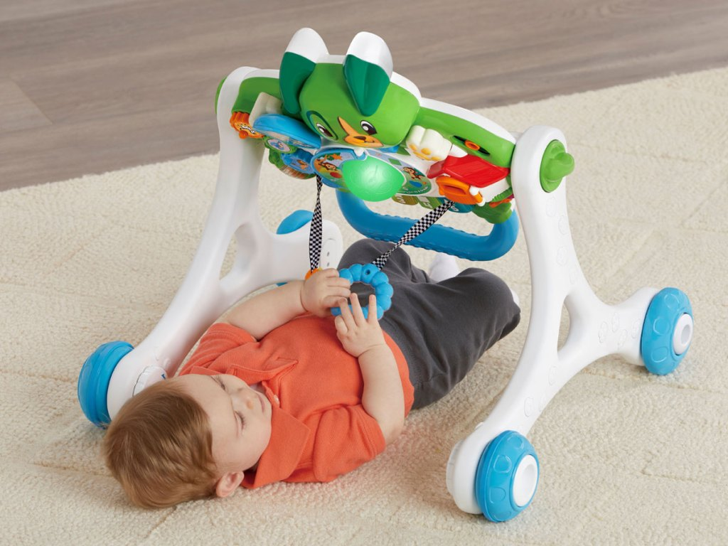 baby on the floor playing with LeapFrog Scout Walker