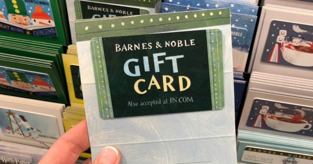 hand holding barnes & noble gift card with gift cards in background